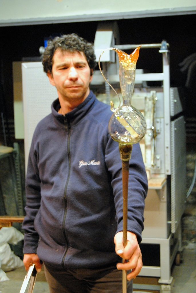 The maestro and the vase he made at the glass blowing demonstration.