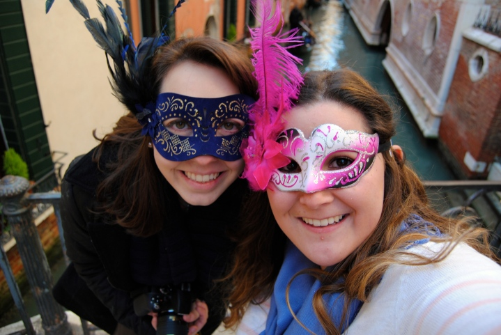 Mel and I with our masks on one of Venice's many bridges.