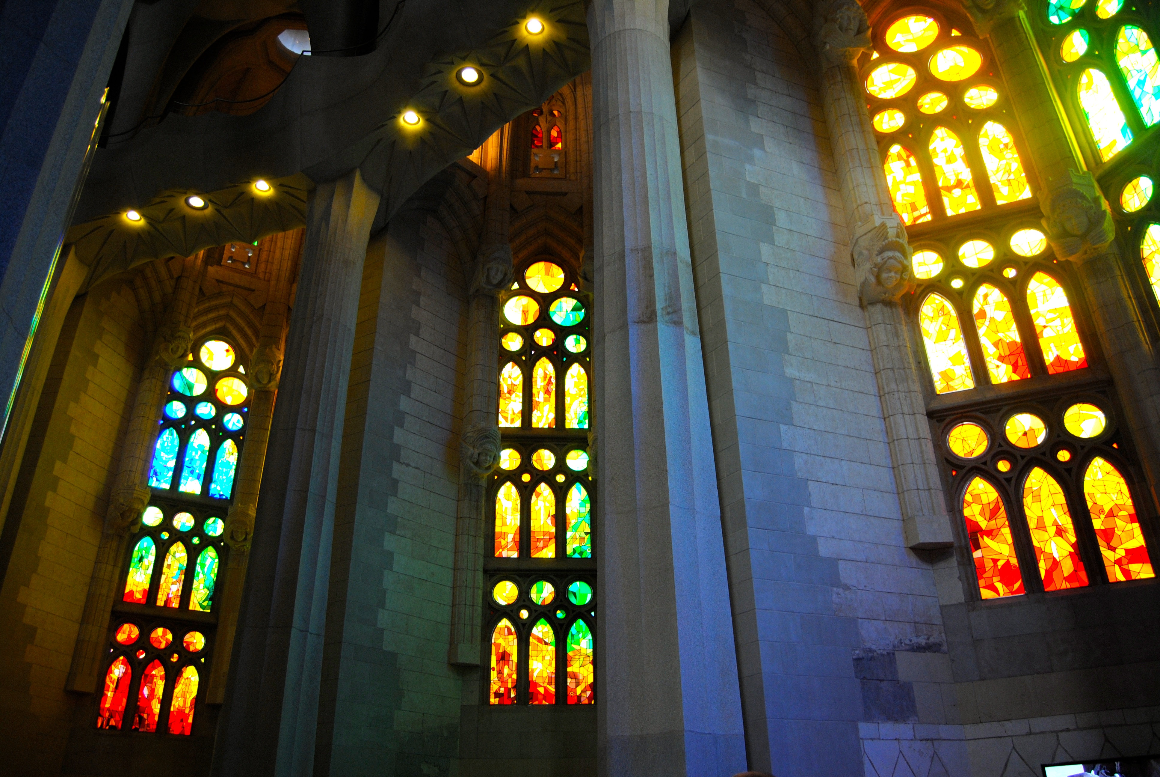 Stained glass windows on the inside of the church.