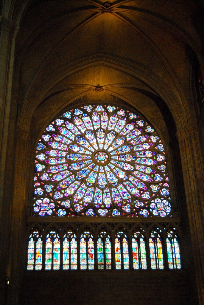 The stained glass window inside of Notre Dame.