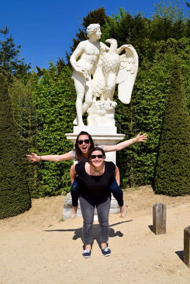 The signature Eagle pose in front of an eagle statue.