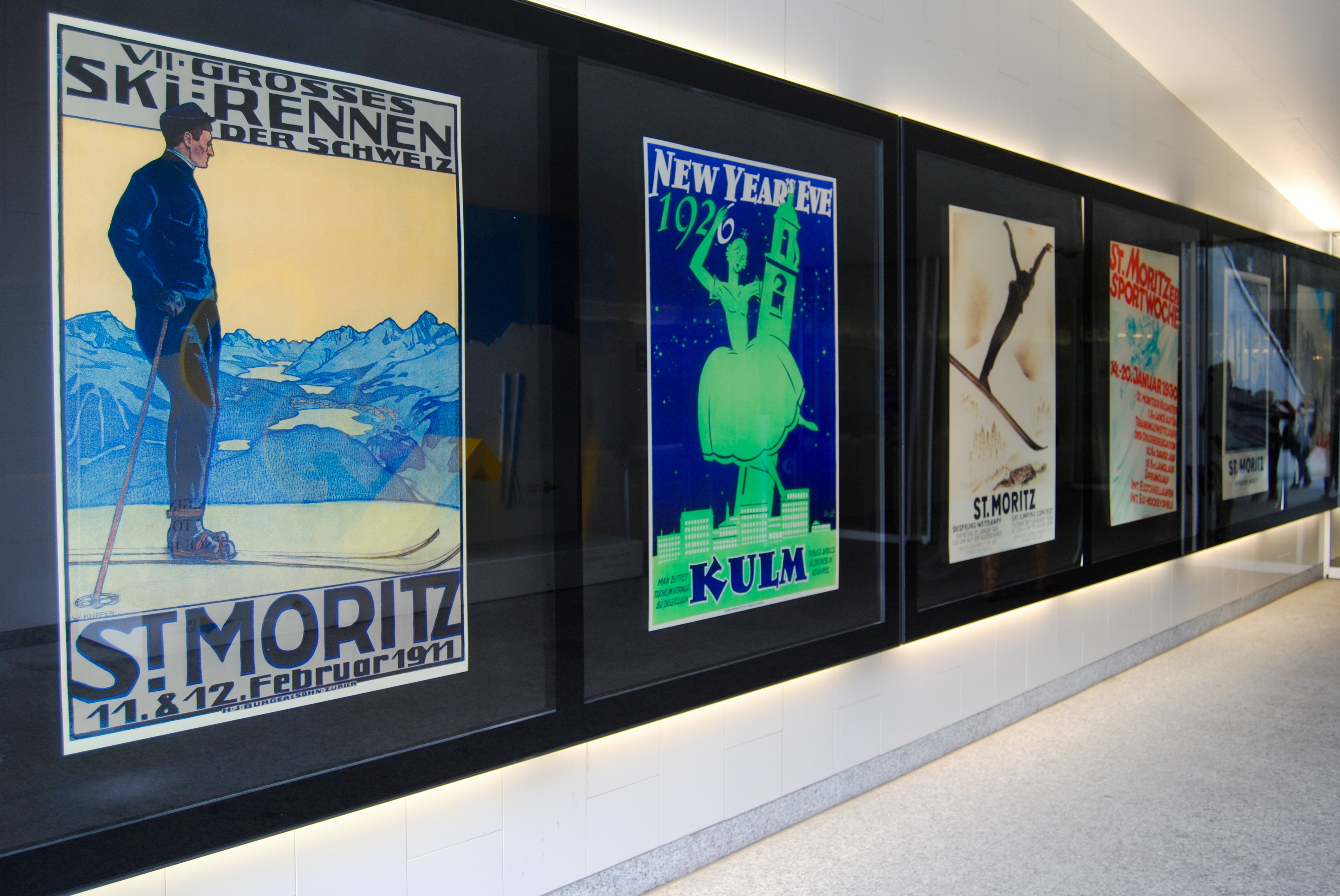 Some of the vintage travel posters inside the hallway leading up to St. Moritz Dorf.